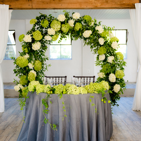 Hydrangea Floral Moongate for Sweetheart Table During a Reception at 48 Fields Farm | Barn Wedding Venue in Leesburg VA