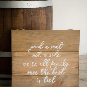 Pick a Seat Not a Side Rustic Wood Sign in the Something Borrowed Wedding Closet | 48 Fields Farm in Leesburg, VA