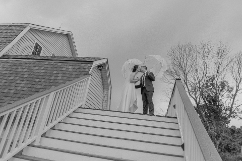 Clear Umbrellas in a Barn Wedding Emergency Kit at 48 Fields Farm in Leesburg VA | Kaitlin and Justin