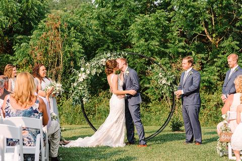 floral ring moongate summer outdoor wedding ceremony - 48 Fields Wedding Barn | Leesburg VA