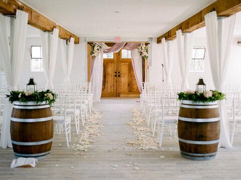 barrels arbor pergola ceremony backdrop indoor ceremony