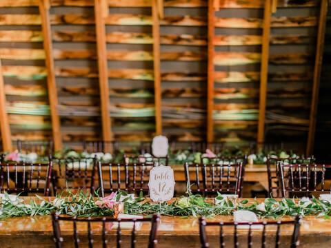 barn wedding table design with greenery