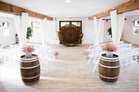 Indoor ceremony setup lower level barn venue 48 Fields