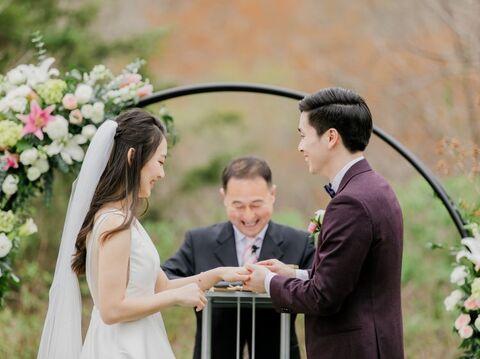 bride groom and officiant outdoor ceremony moon gate - 48 Fields Wedding Barn | Leesburg VA