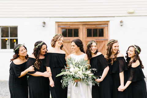 bride and bridesmaids in black dresses with laurel crowns - save money by skipping bridesmaid bouquets - 48 Fields Wedding Barn | Leesburg VA