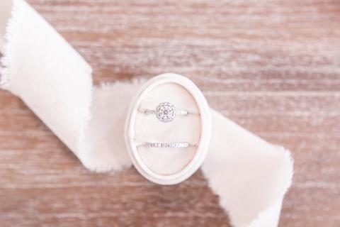 rings in cream oval ring box with white ribbon - 48 Fields Wedding Barn | Leesburg VA