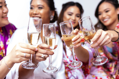 bride and bridesmaids toast with personalized champagne glasses - 48 Fields Wedding Barn | Northern VA