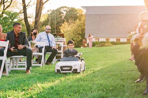 ringbearer in tiny car fun wedding ceremony ideas - 48 Fields Wedding Barn | Northern VA