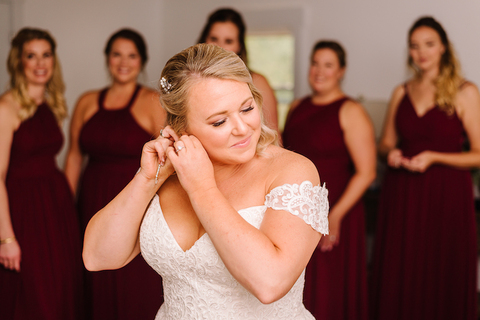 bride getting ready surrounded by bridesmaids fall wedding - 48 Fields Wedding Barn | Northern VA