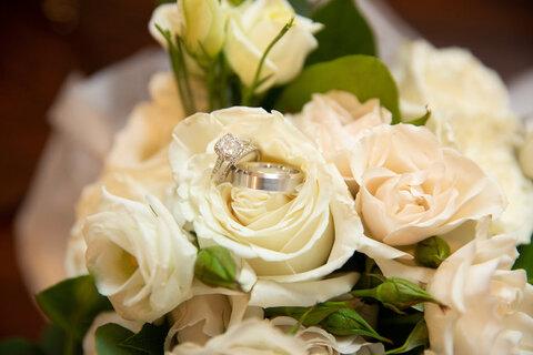 rings on bouquet getting ready fall micro wedding - 48 Fields Wedding Barn | Leesburg VA