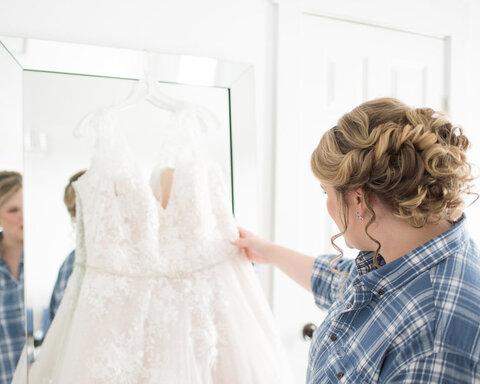 bride looking at wedding dress getting ready - 48 Fields   Leesburg VA