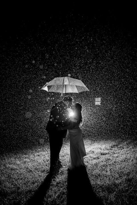 clear umbrella kiss photos rain on wedding day tips - 48 Fields Wedding Barn | Leesburg VA