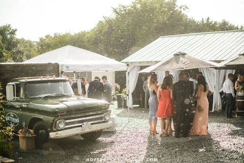 cocktail hour with umbrellas rain on wedding day tips - 48 Fields Wedding Barn | Leesburg VA