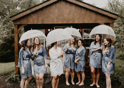 bridesmaids with clear umbrellas rain on wedding day tips - 48 Fields Wedding Barn | Leesburg VA