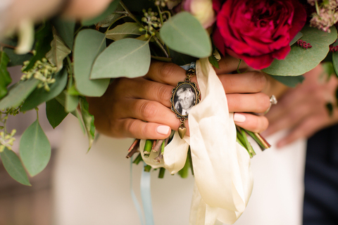 bride with photo of father bouquet charm how to remember loved ones - 48 Fields Wedding Barn   Leesburg VA